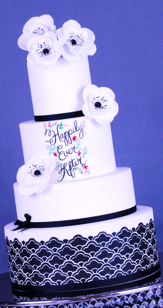 Black and white four-tiered happily-ever-after cake with flowers