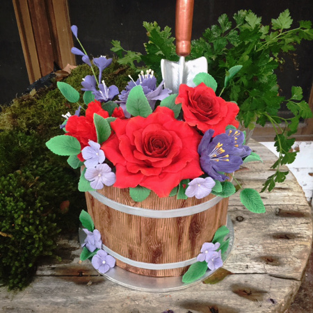 garden themed bucket cake with gum paste roses